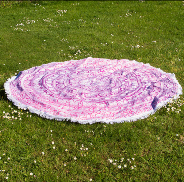 pink circular throw on grass
