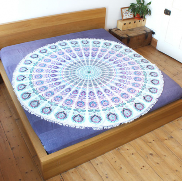 peacock throw on bed